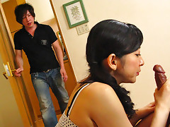 Sensual dark haired hottie Emiko Koike gets her hands on her young lovers rock hard dick and gets his friends rod as well as he joins in for a nasty living room threesome,where they use sex toys at first and then their hard boners on her hairy pussyvideo